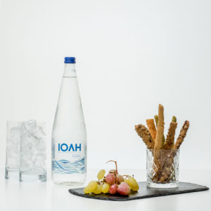 Bottle Of Still Water With Fruits And Bread Selection