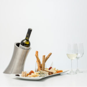Bottle Of White Wine With Cheese Platter And Dried Fruits