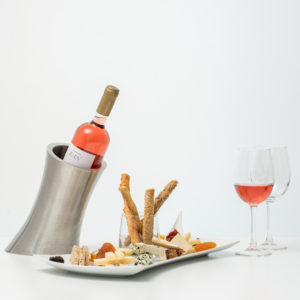 Bottle Of Rose Wine With Cheese Platter And Dried Fruits